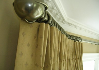 Detail of double pleat heading and finial