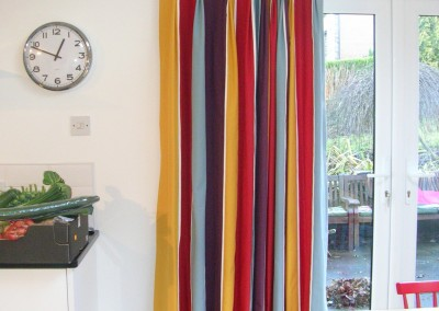 Stripy curtains hung from white pole