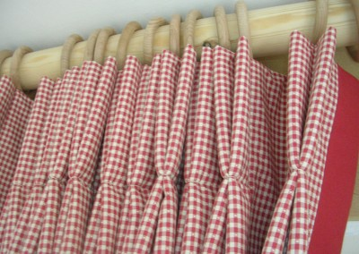 Detail - double pleat curtains with a red leading edge