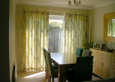 Dining area curtains hung from a cream pole