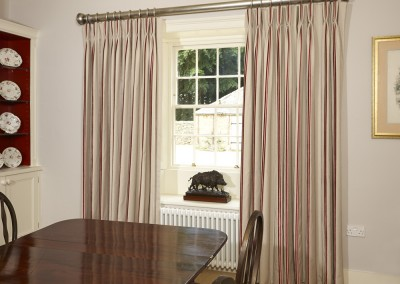 Dining room - curtains with triple pleats hung from a silver pole