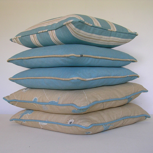 Scatter cushions with contrast piping
